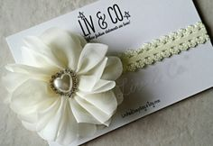 This hair piece was designed with my dream beach wedding in mind. Very light & elegant. As with all of our designs, this headband is not only fit for a bride, but is a great addition to any baby, toddler, & kid girl's headband stash! It truly makes a statement. Liv & Co.™ headbands for babies, kids, & adults make the perfect gift for any occasion and also make great photo props! This headband features a pastel yellow/creme picot elastic fastened to a gorgeous white flower embellished with a…