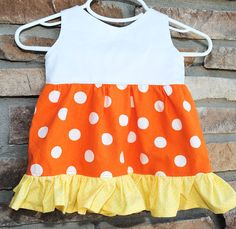 Use this adorable little candy corn dress tutorial for your baby girl with this free pattern instructions. Perfect for Halloween.