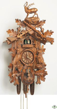 German Wood-Carved Cuckoo Clock, bringing this back from Germany this summer for our first home :)