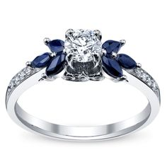 Nice accent - but maybe just a little too much on the design though. 14K White Gold Diamond Engagement Ring 1/2 Carat Total Weight