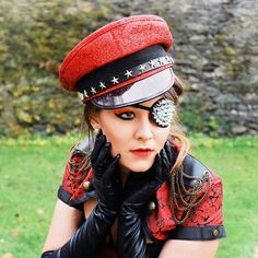 #photography #portraitphotography #portrait #outdoor #model #photomodel #photoshoot #photooftheday #fotoshooting #face #woman #earrings #militarystyle #red #gloves #fetish #corsage #bolero #militarycap #patch  #eyepatch #spikes #glitter #redeyeshadow #cateyes #makeup #lipgloss #longgloves #jewelry