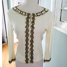 Ivory Beaded Cardigan Gorgeous detailing on this Ivory. Cotton cardigan embellished around neckline and down the front with gold beading and clear stones, also decorated on the sleeve cuffs hook and eye front closure Joyous & Free Jackets & Coats