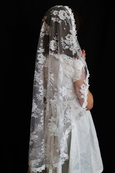Available in white for First Holy Communion and in black and ivory for other occasions, this incredibly soft Chantilly lace mantilla features beautiful roses and daisies in the lace pattern. The veil cascades from the top of the head to the back 30 inches, and is finished with a simple narrow scalloped trim.