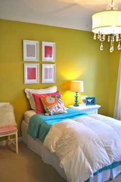 Darling little bedroom featured on BeColorful.  Love the brights, chandelier.