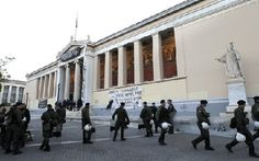 Fourteen face charges after police enter Athens University grounds, ending sit-in