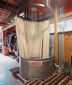 The showers are made from stock-watering tanks from the Ideal Stock Tank Co. and have waterproof canvas curtains. Less expensive than pre... Dream Barn, My Dream Home, Piscine Diy, Canvas Curtains, Galvanized Tub, Hunting Cabin, Barndominium, Bricks, New Homes
