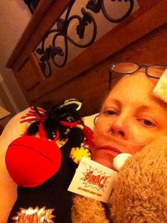 Penny snuggling with Phoenix and says  he is helping to cushion all of her sore spots.   Give someone you love with/impacted by #cancer a SMAC! monkey for some love & comfort through their journey. Order here: smacmonkey.com/ #SMACancer #beatcancer #lungcancer