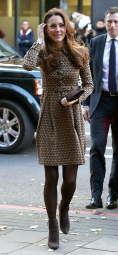 Kate Recycles Orla Kiely for a Visit With William to Only Connect 11/19/13  (The brown patterned coat-dress first appeared during a visit to an Oxford school in February 2012, as did her suede boots and clutch bag.)