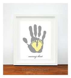 Gift for New Mom - Baby Footprint Art Yellow and Gray Nursery - Personalized Mother - Baby's First Christmas - gifts under 50. $40.00, via Etsy.