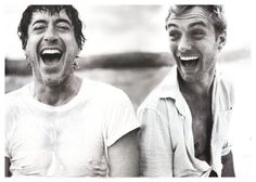 Laughing Downey and Law, co-stars in the newest Sherlock Holmes movies...love them!!!