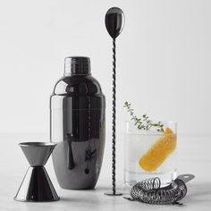 A rich, lustrous gunmetal finish lends a contemporary edge to our stainless-steel bar tools. This four-piece set stocks your home bar with essentials for measuring, mixing and straining cocktails, so you can serve drinks in style. Cocktails To Try, Fall Cocktails, Barista, Bar Spoon, Home Bar Decor, Home Bar Designs, Stainless Steel Bar, Bar Tools, Cocktail Shaker