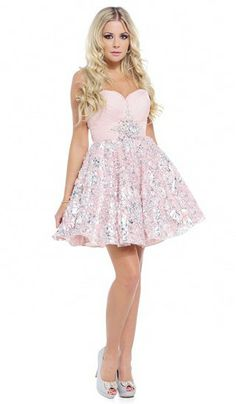 A chiffon dress, with a short flirty skirt, embellished with silver swirls, from Ruby Prom.