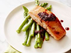 Steamed asparagus makes a perfect bed for tender salmon fillets, with no oil needed.