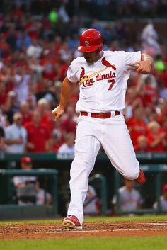 Matt Holliday scores a run against the Reds in the first inning. Cards won the game 6-5 in the 10th.  8-18-14