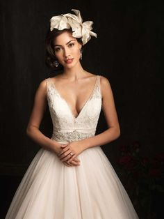 The English Net has many layers which makes the skirt full and beautiful and the belt around the lace-applique bodice is stunning as it is embellished in the front center with a magnificent display of Swarovski crystals.   #timelesstreasure