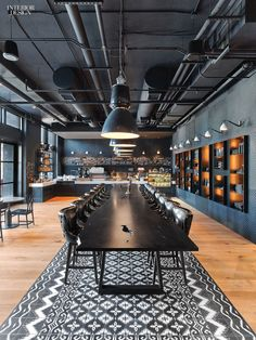Vintage Industrial Decor Mark Zeff Riffs on Austin's Musical Heritage at the Hotel Van Zandt - Café custom communal table is topped in ebonized walnut. Photography by Eric Laignel. Modern Office Decor, Industrial Office Design, Vintage Industrial Furniture, Industrial House, Industrial Interiors, Industrial Lighting, Industrial Style, Office Ideas, Modern Lighting