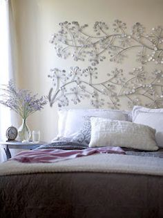 vintage iron scrollwork painted the same color is another good idea for DIY headboards