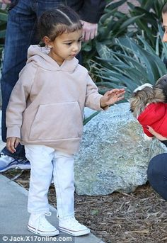 North West rocks a fur coat with Penelope and auntie Kourtney