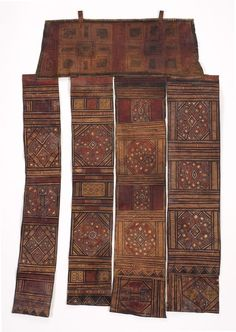 """Tuareg Tent hanging Tuareg People; Morocco, Mali or Niger  Early 20th Century Leather, painted, embossed and embroidered with white cotton thread. Size: 43"""" long x 27 1/2"""" wide  (109 x 70 cm) This exceptional piece was probably kept because of the high quality and reconfigured into present form.  The """"Moorish"""" designs indicate that it could have been made by Tuareg people from Morocco."""