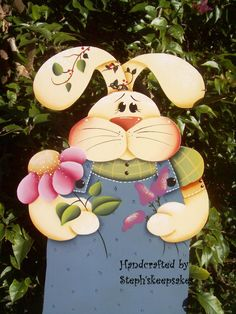 Bloomin' miss bunny hanger, Wooden Girl  Easter Bunny,Holiday, Welcome Greeter, Home Decor. $32,95, via Etsy.