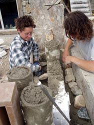 slipform stone masonry | Students participate in a class on slipform stone masonry.