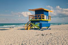 A photo tour of Miami Beach lifeguard stands Miami Beach, Palm Beach, Beach Wedding Setup, Beach Lifeguard, The Neighbourhood, Tropical, Skyline, Tours, Explore