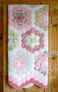 Grandmother's Flower Garden. I love hexi quilts and this one is so soft and pretty. I guess we could dig into some scraps, too. ;)