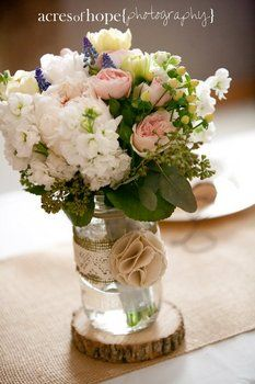 Decorate mason jars with burlap and lace for the bride & bm's bouquets for during the reception. Makes cute centerpieces