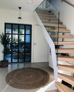 LUMO is a very versatile staircase as it can be made straight, 180 winder or U-shaped with a landing. Postless glass railing withstands the knocks of living and lets the light reflect beautifully on the steps of the stairs.