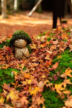 Jizo statue is ready for winter at Sanzen-in temple, Kyoto, Japan