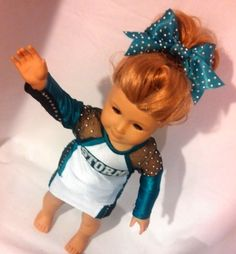 Custom cheer uniform! Yes those are crystals all over the bow, on the mesh sleeves, under the arms and down the sides of the skirts - WOW!