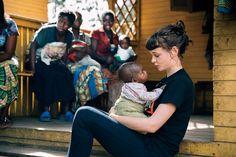 Carey Mulligan cradles an infant at War Child UK's center for vulnerable girls in Goma, DRC. - Photo: War Child, James Marcus Haney, DRC