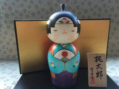 Bambola Kokeshi, Momotaro