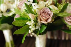 Beautiful spring wedding with classic spring flowers in pastel shades. Tulips - lily of the valley - ranunculus - anenomes - hyacinth - roses. Wedding styling and flowers by Ava Event Styling. Photographer: Richard Shephard Venue: Hampton Manor, country manor house (Solihull, West Midlands, UK)