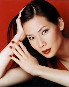 Lucy Liu in an advert for 'Revlon'. (1999)