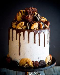 October 9, 2016 This quite is a mouthful, quite literally. Layers of chocolate and white cake are separated by brownie bits, Oreos, chocolate chip cookies, whipped vanilla buttercream, as well as ...