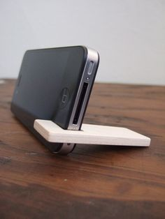 iPhone 4 and 4S stand. maple with chocolate felt lining. via Etsy