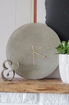 DIY Projects Made With Concrete - Simple DIY Concrete Clock - Quick and Easy DIY Concrete Crafts - Cheap and creative countertops and ideas for floors, patio and porch decor, tables, planters, vases, frames, jewelry holder, home decor and DIY gifts. Modern, Rustic and Farmhouse Decor Ideas http://diyjoy.com/diy-projects-concrete
