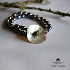 Moonbeams Jewelry by Adity Karande. Handmade Bracelet: Coin Shell, Tourmaline, White Topaz, and Coffee Pearl on Sterling Silver.