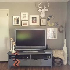 Gallery wall above tv. West elm deer bust photo display and tv