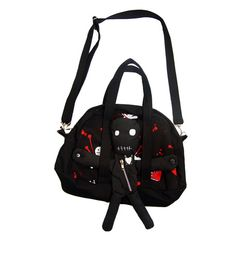 From Poizen Industries UK  This awesome black denim bag features an all over voodoo print, adjustable and detachable shoulder straps, and a detachable voodoo doll! Zipper closure. Zipper pocket is also on the doll.