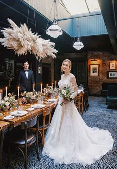 A vintage black and gold moody candlelight wedding with still life flowers and a hanging dried grass chandelier for an intimate pub celebration!
