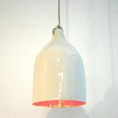 White porcelain lamp with gold glazed interior.  Melanie's pin