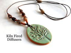#TreeofLife #handmade diffuser necklace crafted using Tibetan Spiritual Agate Dzi Beads. Adjustable cord with a beautifully glazed pendant >>
