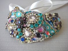 Yet another stunning creation from OOAKjewelz on Etsy. I love the mix of 'friendship bracelet' braiding with the gorgeous rhinestones.