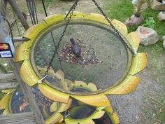A bird feeder from a used tire, spray painted with mesh for the seeds.