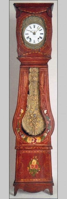 Morbier, a Morez or a Comtoise clock. The case is constructed in spruce and is decorated in its original paint. An added bonus is the colorfully paint decorated flowers.. They are set apart from the base by an applied molding and the paint details.