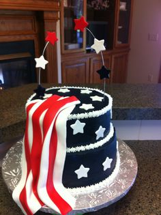 - The cake is covered in buttercream. The stars are fondant, as is the red and white flag. In order to get the color of blue I used, which matches the flag perfectly, you have to add black to blue.