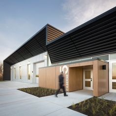 This contemporary firehouse by Canadian studio STGM Architectes features facades made of metal, glass and wood, with interior spaces awash in white finishes and natural light.