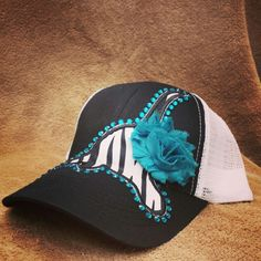 Zebra cow skull with teal flower and stones